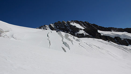 The first crevasses appear in the distance