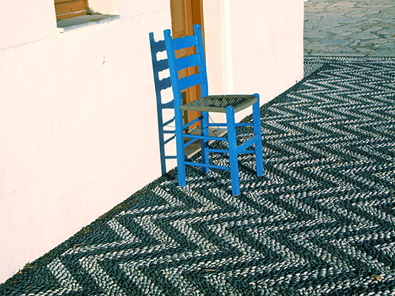 Blue chair in front of the Agios Ioannis church