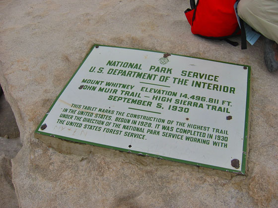 The summit plaque mentioning the former official altitude